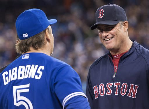 Toronto Blue Jays manager John Gibbons, left, meets with Boston Red Sox manager John Farrell, right, at home plate to exchange lineups during forst-inning baseball game action in Toronto, Friday, April 5, 2013. (AP Photo/The Canadian Press, Nathan Denette)