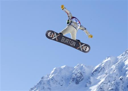 U.S. snowboarder Shaun White takes some air off a jump during a slopestyle snowboard training at the 2014 Sochi Winter Olympics in Rosa Khutor February 3, 2014. REUTERS/Mike Blake
