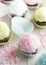 """<p>Who doesn't want a parade of pastel cupcakes topped with marshmallow fluff?</p><p><em><a href=""""http://bakingamoment.com/snowball-cupcakes/"""" rel=""""nofollow noopener"""" target=""""_blank"""" data-ylk=""""slk:Get the recipe from Baking a Moment »"""" class=""""link rapid-noclick-resp"""">Get the recipe from Baking a Moment »</a></em><br></p>"""