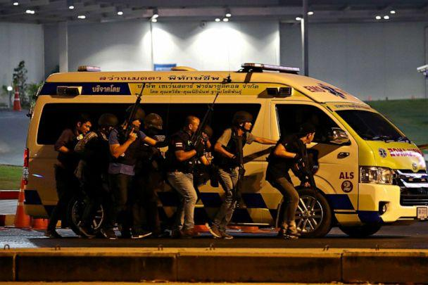 PHOTO: Thai security forces take cover on Feb. 9, 2020 behind an ambulance as they chase a shooter hidden in a shopping mall after a mass shooting in front of Terminal 21 shopping mall in Nakhon Ratchasima, Thailand. (Athit Perawongmetha/Reuters)