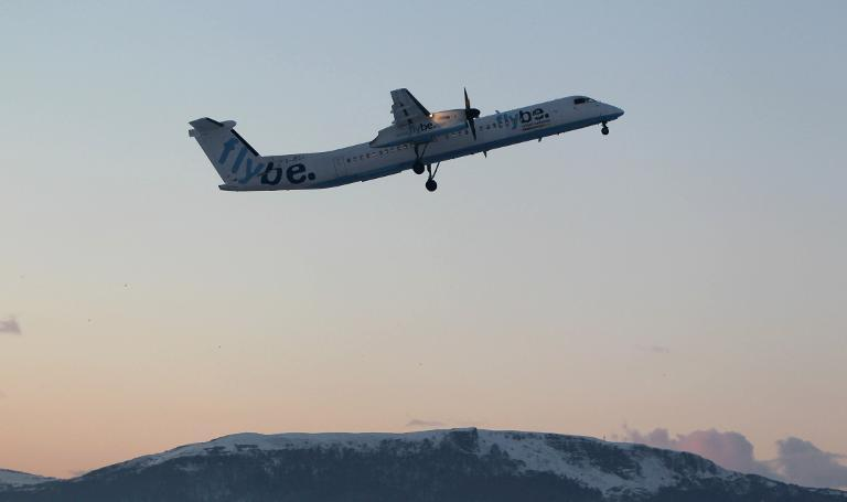 A Flybe aircraft takes off from the Belfast City airport in Northern Ireland on December 23, 2010