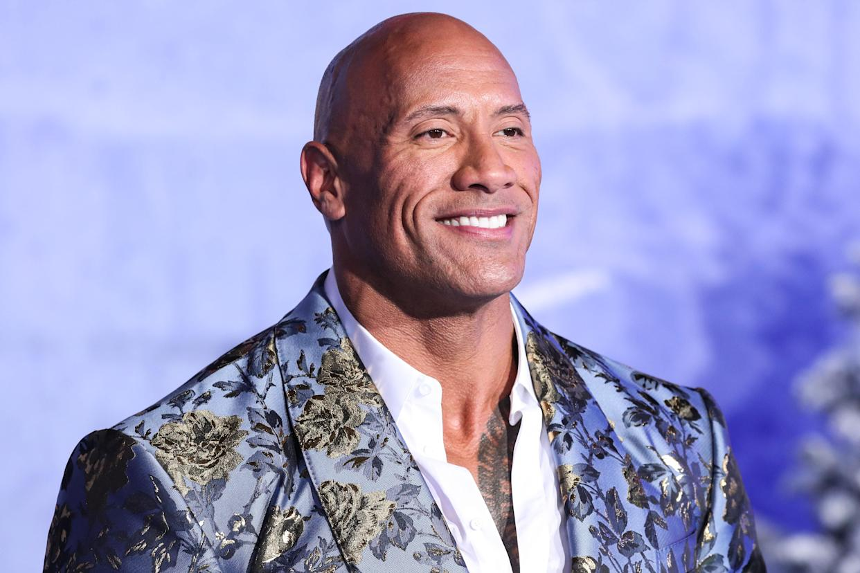 HOLLYWOOD, LOS ANGELES, CALIFORNIA, USA - DECEMBER 09: Actor Dwayne Johnson (The Rock) wearing Dolce & Gabbana arrives at the World Premiere Of Columbia Pictures' 'Jumanji: The Next Level' held at the TCL Chinese Theatre IMAX on December 9, 2019 in Hollywood, Los Angeles, California, United States. (Photo by Xavier Collin/Image Press Agency/Sipa USA)