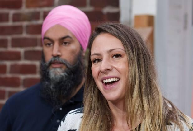 NDP candidate Ruth Ellen Brosseau stands in front of NDP leader Jagmeet Singh introduces candidate during a news conference in Yamachiche, Que., on Sunday. The NDP are on track to have 50 per cent female candidates in the Sept. 20 federal election. (Paul Chiasson/The Canadian Press - image credit)