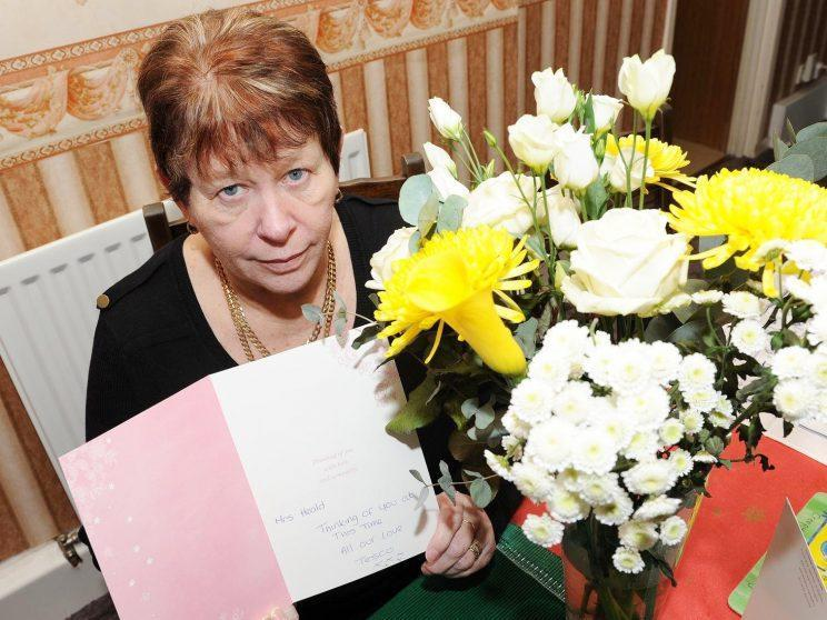 Linda Heald received a card, flowers and a box of chocolates from her Tesco delivery driver [SWNS]