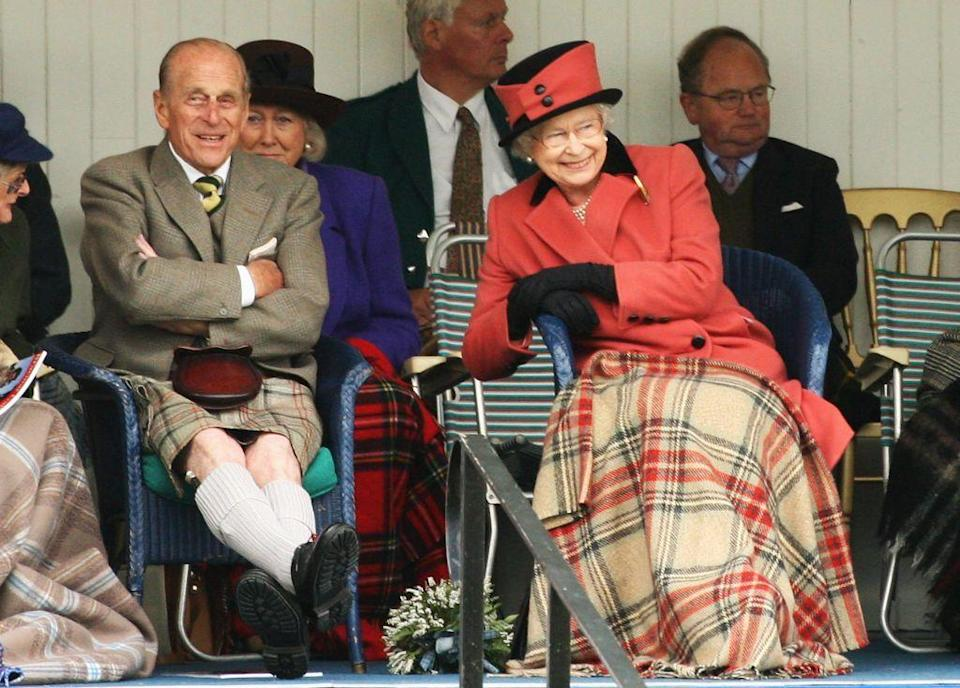 <p>Sharing a laugh with the Queen as they watch the games during the Annual Braemar Highland Gathering in Scotland.</p>