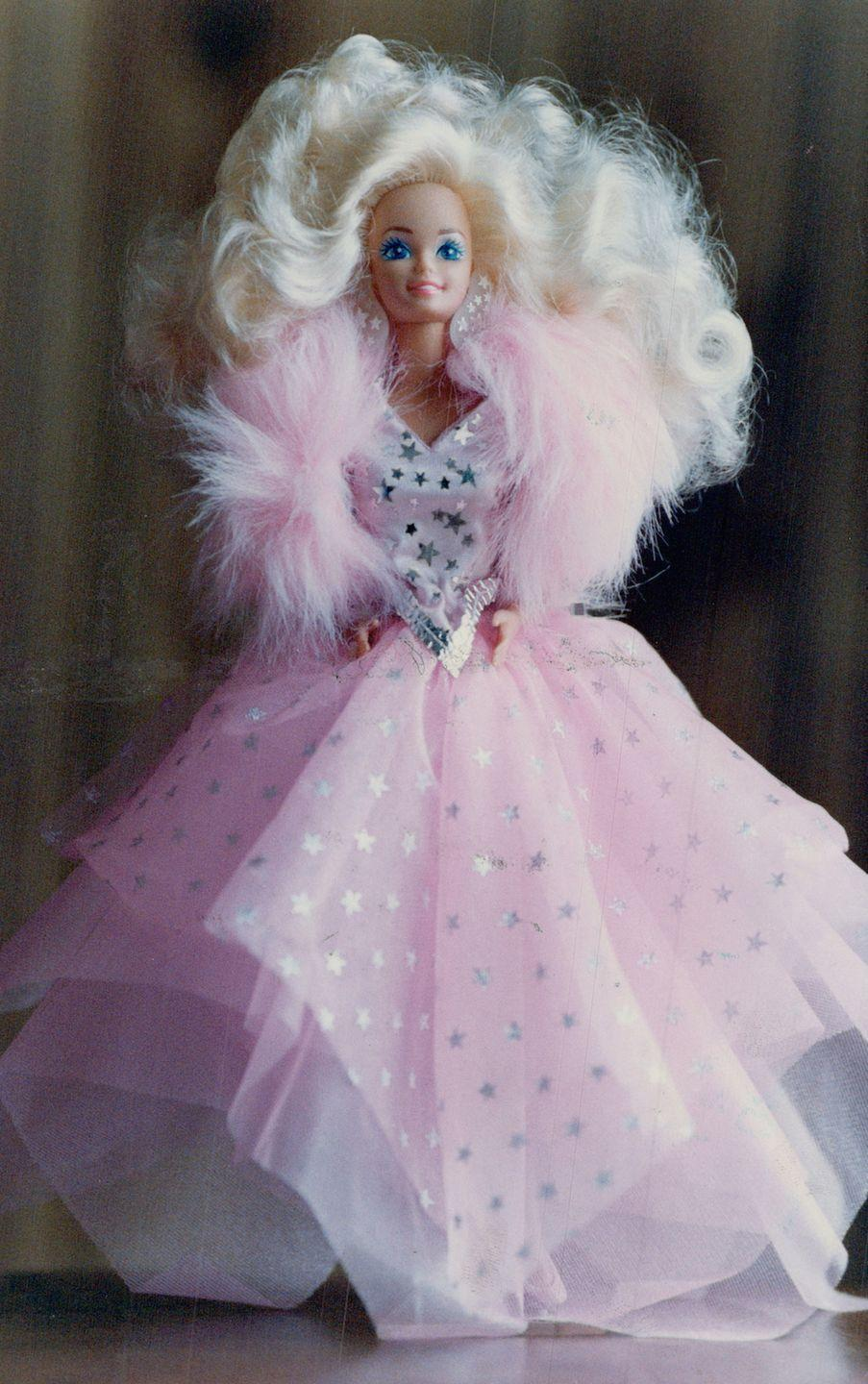 <p>Super Star Barbie says goodbye to the '80s in a big way, with the most voluminous hair we've seen yet, sequins, sparkles, tulle AND a faux fur wrap. </p>