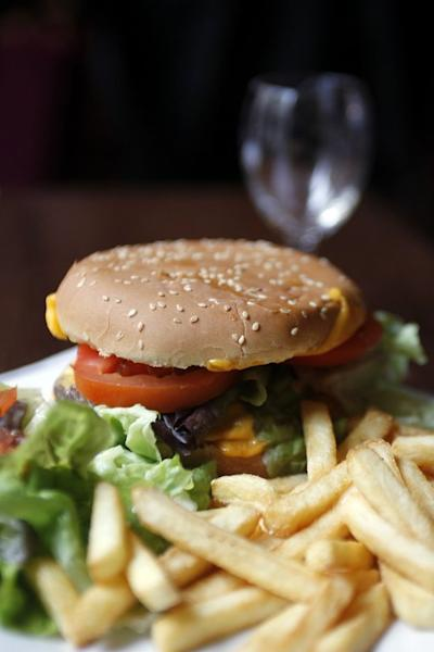 A hamburger and French fries in a restaurant in Paris