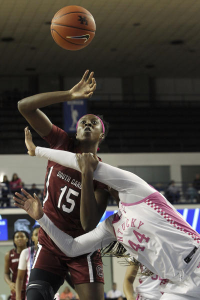 South Carolina's Laeticia Amihere (15) and Kentucky's Nae Nae Cole (44) get tangled up going for a rebound during the second half of an NCAA college basketball game in Lexington, Ky., Sunday, Feb. 23, 2020. South Carolina won 67-58. (AP Photo/James Crisp)