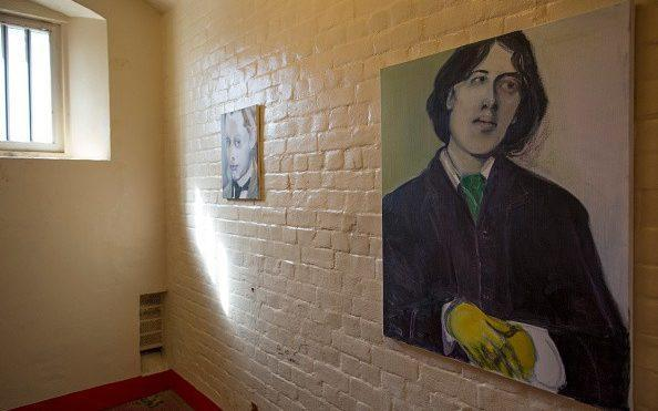 A picture of Oscar Wilde hangs inside a cell inside the former Reading prison as part of a 2016 art project - Getty