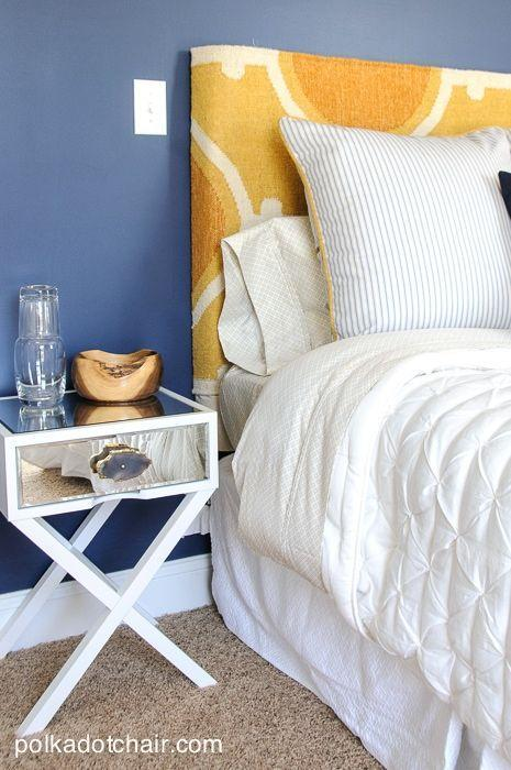 """<p>Having trouble deciding where to start in your basement redesign? Consider building your space around a single beloved piece of decor. This lovely navy and gold guest bedroom was inspired by an antique quilt. We love the way it all came together—including this headboard made from a piece of foam and a rug runner. Mind. Blown. </p><p><strong>See more at <a href=""""https://www.polkadotchair.com/navy-gold-guest-bedroom-2/"""" rel=""""nofollow noopener"""" target=""""_blank"""" data-ylk=""""slk:Polkadot Chair"""" class=""""link rapid-noclick-resp"""">Polkadot Chair</a>. </strong></p><p><a class=""""link rapid-noclick-resp"""" href=""""https://go.redirectingat.com?id=74968X1596630&url=https%3A%2F%2Fwww.walmart.com%2Fip%2FSafavieh-Montauk-Proinsias-Geometric-Area-Rug-or-Runner%2F546956513&sref=https%3A%2F%2Fwww.thepioneerwoman.com%2Fhome-lifestyle%2Fdecorating-ideas%2Fg34763691%2Fbasement-ideas%2F"""" rel=""""nofollow noopener"""" target=""""_blank"""" data-ylk=""""slk:SHOP RUG RUNNERS"""">SHOP RUG RUNNERS</a></p>"""