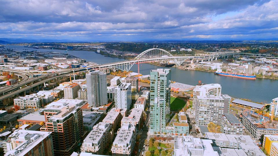 Unique aerial perspective of Fremont Bridge over the willamette river in the pearl district of downtown Portland Oregon on a perfect day.