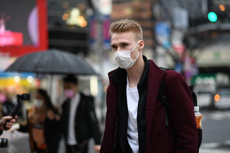 TOKYO, JAPAN - MARCH 2: A tourist wearing protective masks cross an intersection at the Shibuya district in Tokyo, Monday, March 2, 2020. Coronavirus has spread to more than 60 countries and more than 3,000 people have died from the virus known as COVID-19. (Photo: Richard Atrero de Guzman/ Sipa USA)