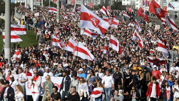 PHOTO: Protesters with old Belarusian national flags march during a Belarusian opposition supporters' rally protesting the official presidential election results in Minsk, Belarus, Sept. 13, 2020. (AP)