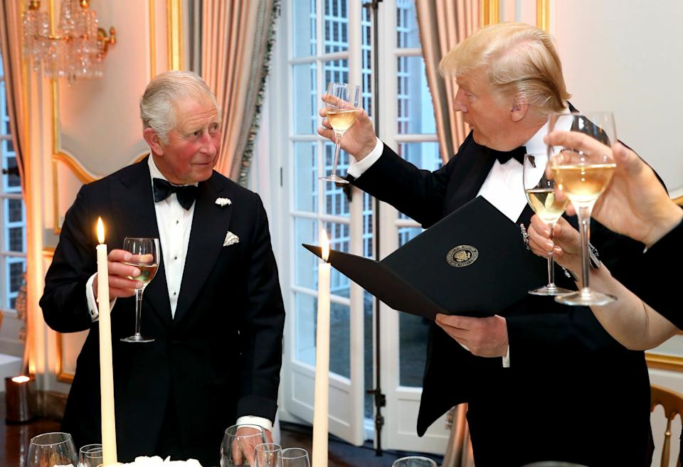 US President Donald Trump and Britain's Prince Charles toast, during the Return Dinner in Winfield House, the residence of the Ambassador of the United States of America to the UK, in Regent's Park, part of the president's state visit to the UK, in London, Tuesday June 4, 2019. (Chris Jackson/Pool Photo via AP)