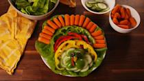 "<p>Save room for all the turkey and mashed potatoes with this veggie platter appetizer. Arrange it like you see here so it resembles a turkey.</p><p>Get the recipe from <a href=""https://www.delish.com/cooking/recipe-ideas/recipes/a56446/crudite-turkey-recipe/"" rel=""nofollow noopener"" target=""_blank"" data-ylk=""slk:Delish"" class=""link rapid-noclick-resp"">Delish</a>. </p>"