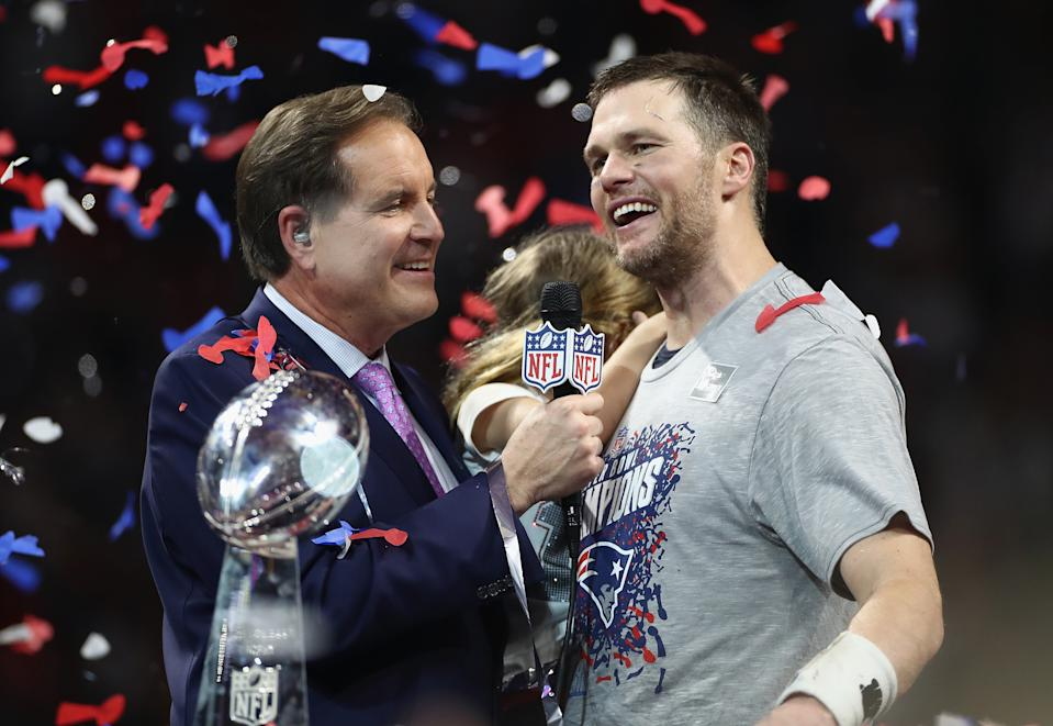 Jim Nantz (L) interviews Tom Brady #12 of the New England Patriots after the Patriots defeat the Los Angeles Rams 13-3 during Super Bowl LIII at Mercedes-Benz Stadium on February 3, 2019 in Atlanta, Georgia.  (Photo by Jamie Squire/Getty Images)