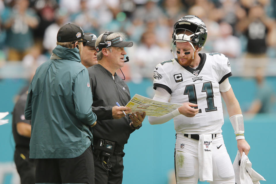 MIAMI, FLORIDA - DECEMBER 01:  Carson Wentz #11 of the Philadelphia Eagles talks with head coach Doug Pederson against the Miami Dolphins during the second quarter at Hard Rock Stadium on December 01, 2019 in Miami, Florida. (Photo by Michael Reaves/Getty Images)