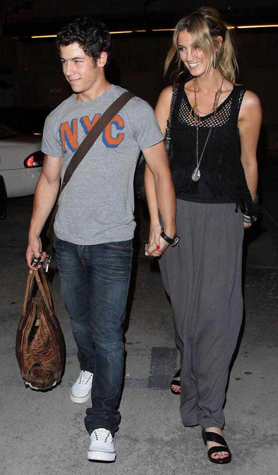 Nick Jonas and Delta Goodrem leaving Pinz Bowling Alley in Studio City, CA. Pictured: Nick Jonas and Delta Goodrem Ref: SPL302987 030811 Picture by: JCalderon / Splash News Splash News and Pictures Los Angeles: 310-821-2666 New York: 212-619-2666 London: 870-934-2666 photodesk@splashnews.com