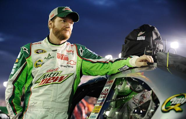 DAYTONA BEACH, FL - FEBRUARY 27: Dale Earnhardt Jr., driver of the #88 Diet Mountain Dew/National Guard Chevrolet, stands on the grid prior to the start of the NASCAR Sprint Cup Series Daytona 500 at Daytona International Speedway on February 27, 2012 in Daytona Beach, Florida. (Photo by Jared C. Tilton/Getty Images for NASCAR)