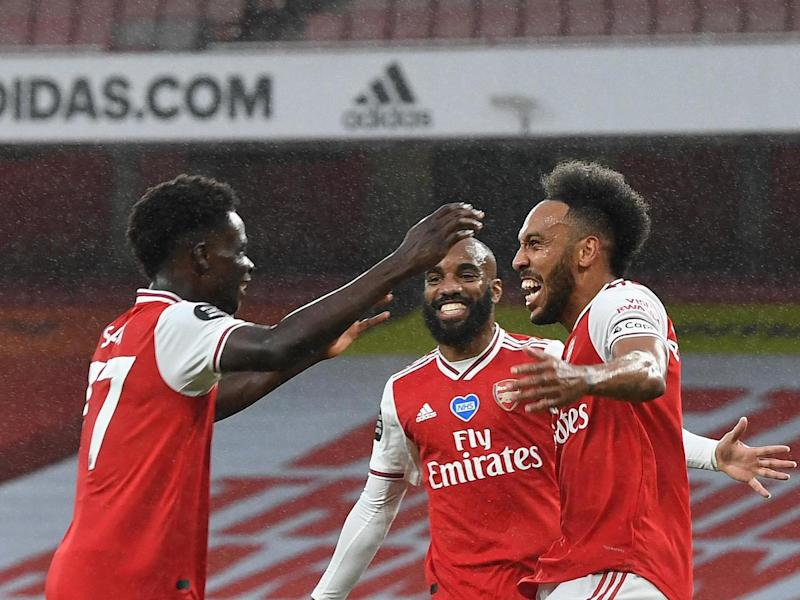 Bukayo Saka, Alexandre Lacazette and Pierre-Emerick Aubameyang celebrate: Getty