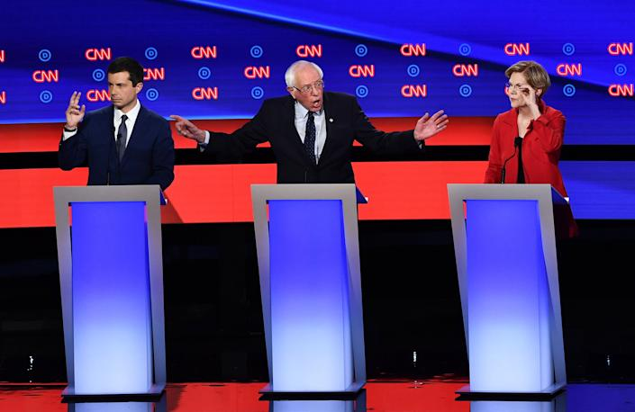 Democratic presidential hopefuls (L-R) Mayor of South Bend, Indiana, Pete Buttigieg, US senator from Vermont Bernie Sanders and US Senator from Massachusetts Elizabeth Warren participate in the first round of the second Democratic primary debate of the 2020 presidential campaign season hosted by CNN at the Fox Theatre in Detroit, Michigan on July 30, 2019. | Brendan Smialowski—AFP/Getty Images