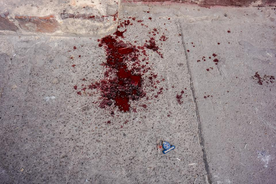 BOGOTA, COLOMBIA - JULY 11, 2014:   Crime Scene. Blood on the streets of Bogota. Bogota has traditionally enjoyed lower homicide rates than other major cities in Colombia. However, street crime in the capital is among the country's highest.  PHOTO BY GILES CLARKE/GETTY IMAGES
