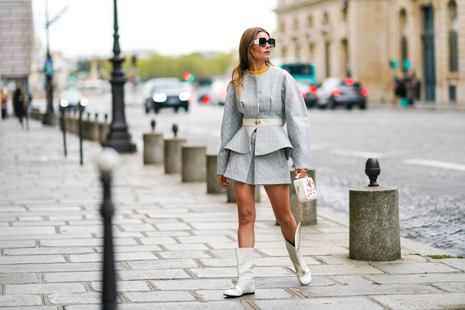 PARIS, FRANCE - SEPTEMBER 28: Natalia Verza wears Pucci sunglasses, a pale blue dress with geometric patterns from Lanvin, a Lanvin belt, a Lanvin bag with golden chain and printed lips, Lanvin white long boots, on September 28, 2020 in Paris, France. (Photo by Edward Berthelot/Getty Images)