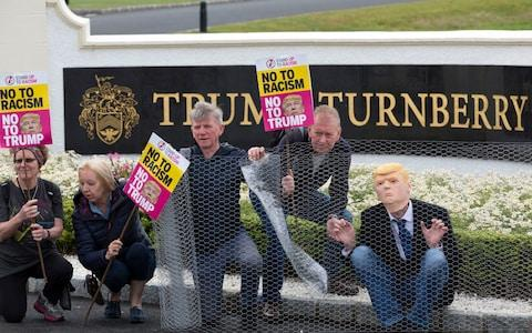 Activists from Stand Up to Racism Scotland (SUTR) stage a protest at the Trump Turnberry resort in South Ayrshire, ahead of the US president's arrival in the UK - Credit: PA