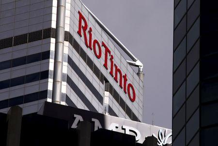 FILE PHOTO - A sign adorns the building where mining company Rio Tinto has their office in Perth, Western Australia