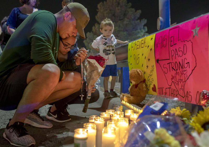 Rene Aguilar and Jackie Flores pray at a makeshift memorial for the victims of Saturday's mass shooting at a shopping complex in El Paso, Texas, Sunday, Aug. 4, 2019. (Photo: Andres Leighton/AP)