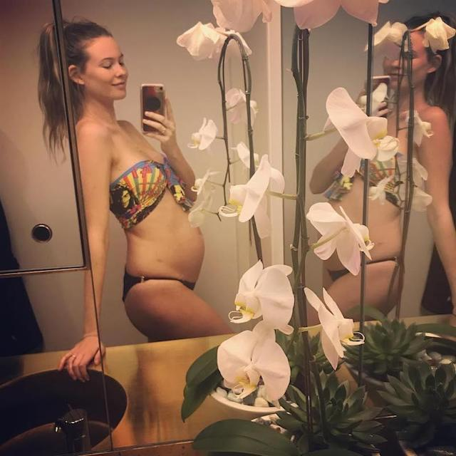 """<p>The Victoria's Secret stunner, who is married to Adam Levine, announced their second joint production. """"ROUND 2….."""" she wrote. Their daughter, Dusty Rose, will turn 1 this month. (Photo: <a href=""""https://www.instagram.com/p/BY_wvTBFIMm/?hl=en&taken-by=behatiprinsloo"""" rel=""""nofollow noopener"""" target=""""_blank"""" data-ylk=""""slk:Behati Prinsloo via Instagram"""" class=""""link rapid-noclick-resp"""">Behati Prinsloo via Instagram</a>) </p>"""