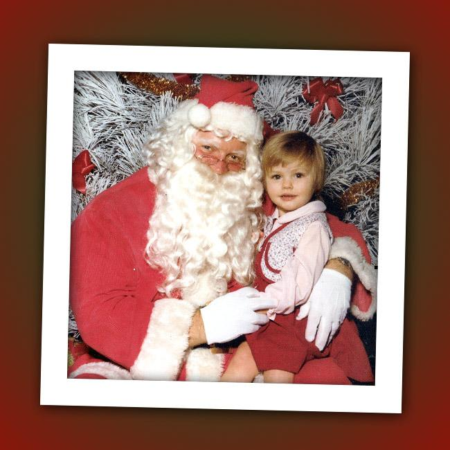 This little Christmas elf might have asked Santa for a stethoscope and thermometer. Who is that future MD on Santa's lap?