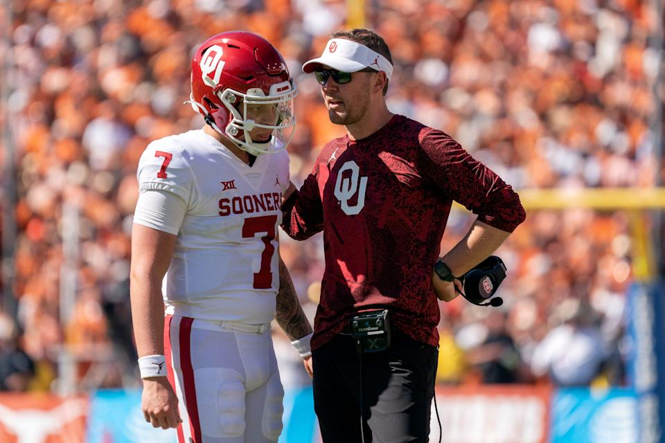 Oklahoma head coach Lincoln Riley talks to quarterback Spencer Rattler during the Red River Showdown.