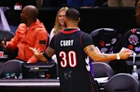 Rapper Drake is seen wearing a Dell Curry jersey before Game One of the 2019 NBA Finals between the Golden State Warriors and the Toronto Raptors at Scotiabank Arena on May 30, 2019 in Toronto, Canada. (Photo by Vaughn Ridley/Getty Images)