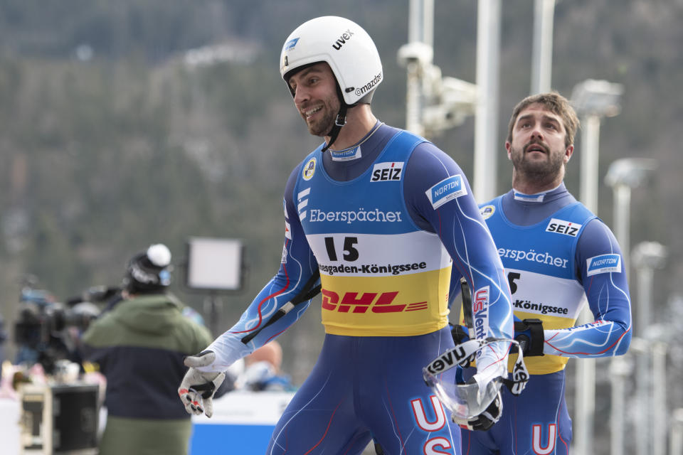 Chris Mazder and Jayson Terdiman of USA react in the finish area after their men's doubles race at the Luge World Championships in Koenigssee, Germany, Saturday Jan. 30, 2021. (AP Photo/Andreas Schaad)