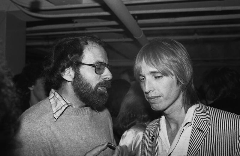 Chatting with Los Angeles Times pop critic, Robert Hilburn, backstage at a 1980 Santa Cruz, CA.