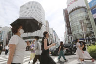 People wearing face masks to help protect against the spread of the coronavirus walk along a street in Tokyo Monday, Aug. 23, 2021. (AP Photo/Koji Sasahara)