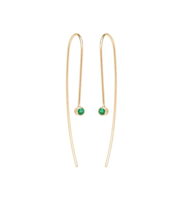 """<p>Emerald wire earrings in 14-karat yellow gold with 2.5mm emeralds, $395, <a href=""""https://zoechicco.com/products/14k-emerald-wire-earrings"""" rel=""""nofollow noopener"""" target=""""_blank"""" data-ylk=""""slk:zoechicco.com"""" class=""""link rapid-noclick-resp"""">zoechicco.com</a> </p>"""
