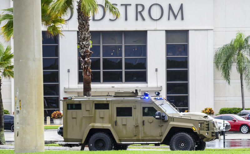 An armored police vehicle enters the Town Center at Boca Raton parking lot in front of Nordstrom, Sunday, Oct. 13, 2019, in Boca Raton, Fla., as the mall had been placed on lockdown following reports of shots fired. (Andres Leiva/Palm Beach Post via AP)