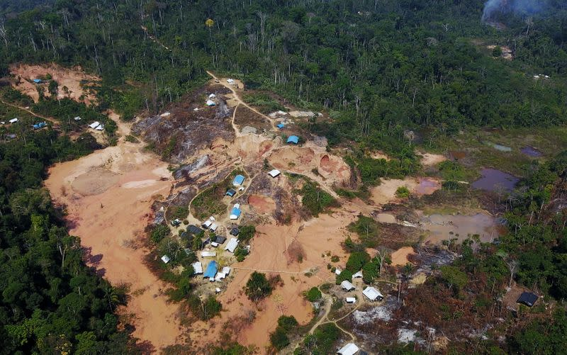 FILE PHOTO: An aerial view show a wildcat gold mine, also known as a garimpo, at a deforested area of the Amazon rainforest near Crepurizao