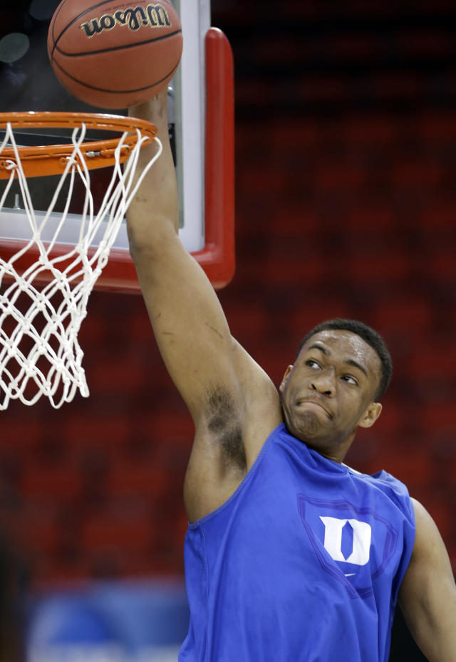 Duke's Jabari Parker goes up to dunk during practice at the NCAA college basketball tournament in Raleigh, N.C., Thursday, March 20, 2014. Duke plays Mercer in a second-round game on Friday. (AP Photo/Gerry Broome)