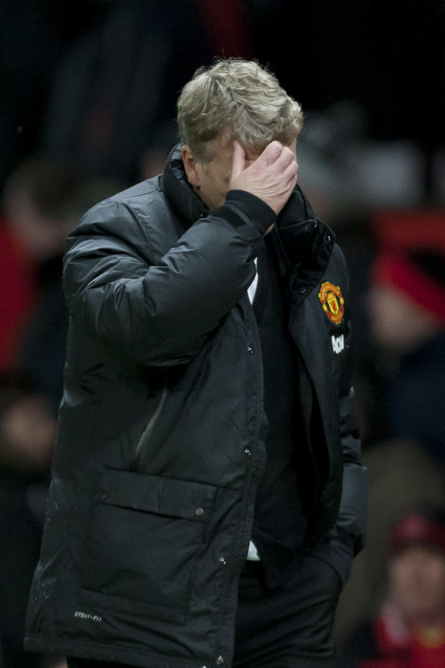 Manchester United's manager David Moyes walks from the pitch after his team's 2-1 loss to Swansea City in their English FA Cup third round soccer match at Old Trafford Stadium, Manchester, England, Sunday, Jan. 5, 2014. (AP Photo/Jon Super)