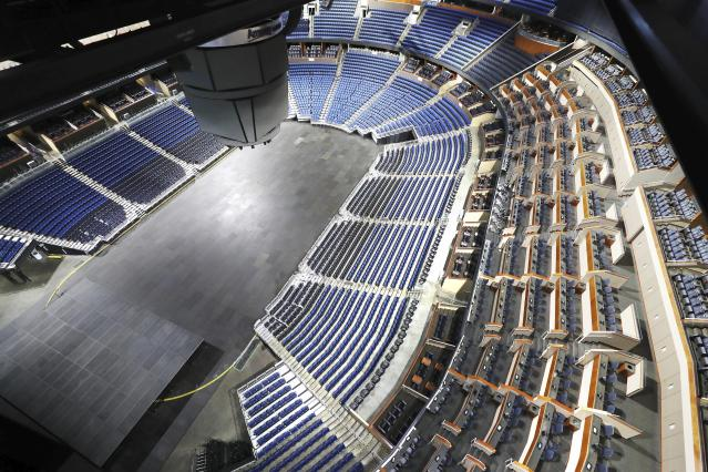 The seats are empty at the Amway Center in Orlando, home of the NBA's Orlando Magic, on Thursday, March 12, 2020. The NBA has suspended the season due to the coronavirus. (Stephen M. Dowell/Orlando Sentinel via AP)