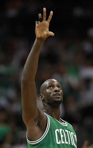 Boston Celtics power forward Kevin Garnett (5) points skyward after scoring during the first half of Game 5 of an NBA first-round playoff series basketball game against the Atlanta Hawks Tuesday, May 8, 2012, in Atlanta. (AP Photo/John Bazemore)