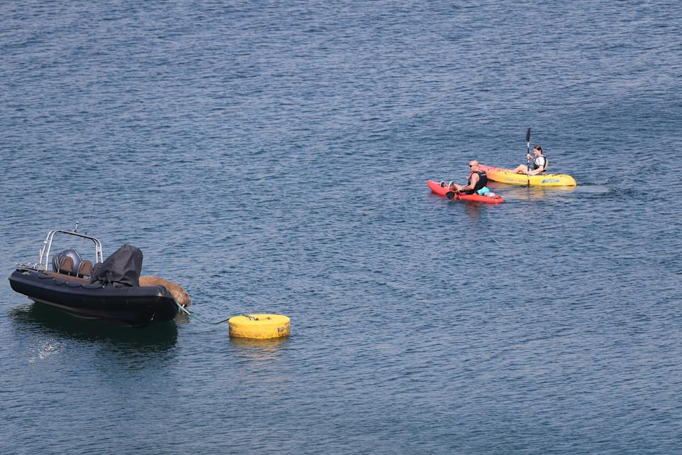 Canoeists row past Wally in Ardmore (Niall Carson/PA) (PA Wire)