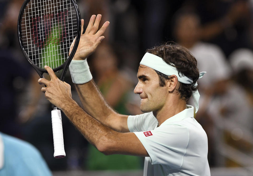 Roger Federer, of Switzerland, acknowledges the fans after his 6-2, 6-4 win over Denis Shapovalov, of Canada, during the semifinals of the Miami Open tennis tournament Friday, March 29, 2019, in Miami Gardens, Fla. (AP Photo/Jim Rassol)
