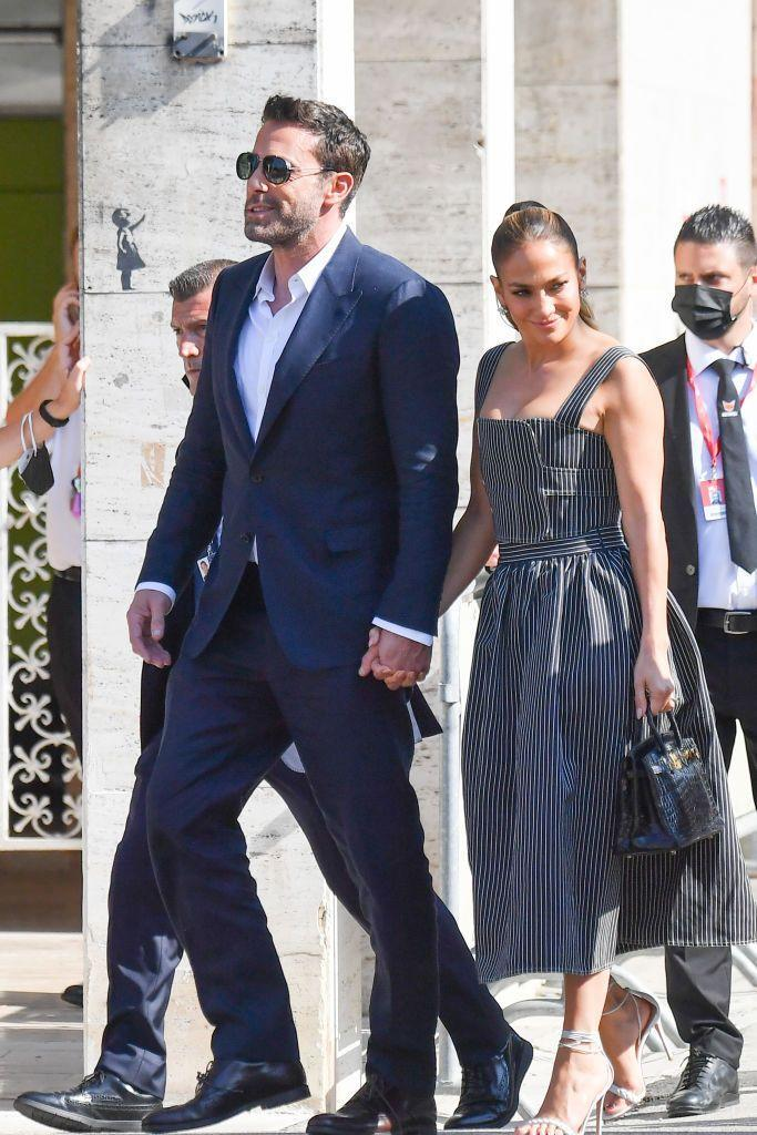 <p>Prior to the premiere, Lopez wore a Dior pinstripe gown to accompany partner Affleck on his promotional duties for his latest film, The Last Duel.</p>