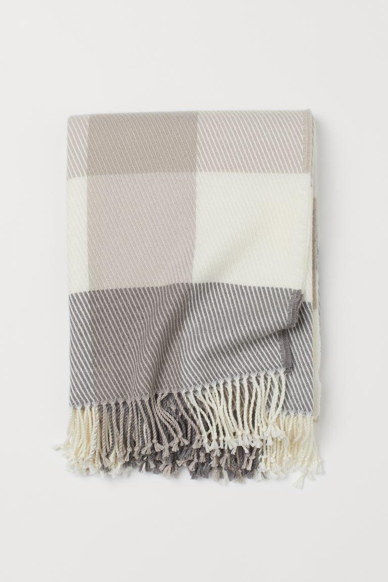 <p>Stay cozy with this <span>H&amp;M Wool-Blend Throw</span> ($60).</p>