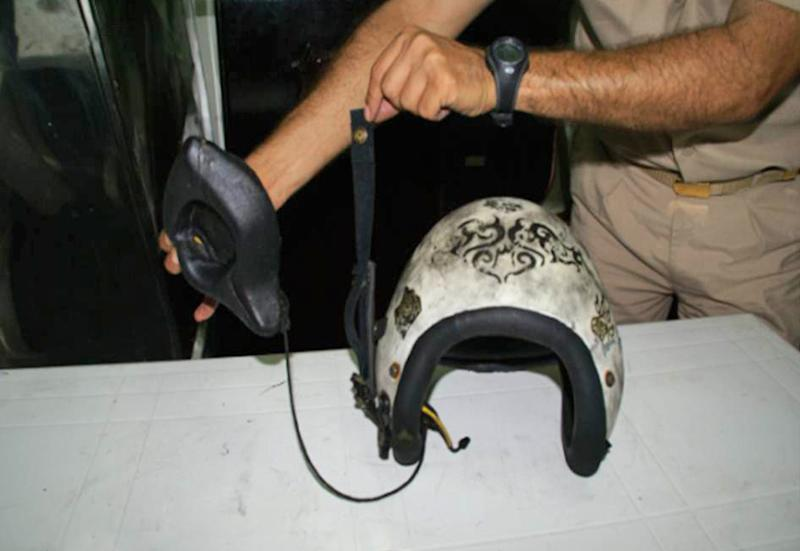 This photo taken Wednesday, July 4, 2012 and provided by the Turkish military, shows the helmet of one of the Turkish pilots of an RF-4 Phantom jet which was shot down by Syrian forces June 22, 2012. Turkey says the plane was hit in international airspace, but Syria insists it was flying low inside Syrian airspace. The bodies of two Turkish pilots were recovered from the seabed on Thursday July 5, 2012 after U.S. ocean explorer Robert Ballard, best known for discovering the wreck of the Titanic, helped locate them nearly two weeks after their jet was shot down by Syria. A Turkish official said Ballard, aboard his deep-sea exploration vessel R/V Nautilus, found the bodies Wednesday 8.6 nautical miles off the Syrian coast after the Turkish navy had pinpointed the area. (AP Photo/Turkish Military)