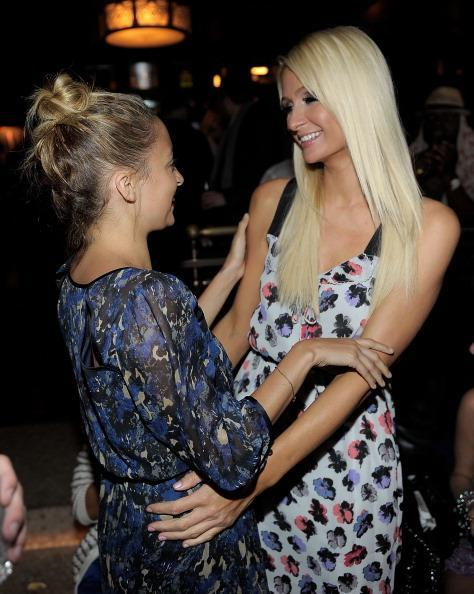 Nicole Richie and Paris Hilton are happy to see each other at a 2011 party in Hollywood. (Photo: Charley Gallay/WireImage)